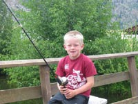 Child fishing at Talk Tech Camp